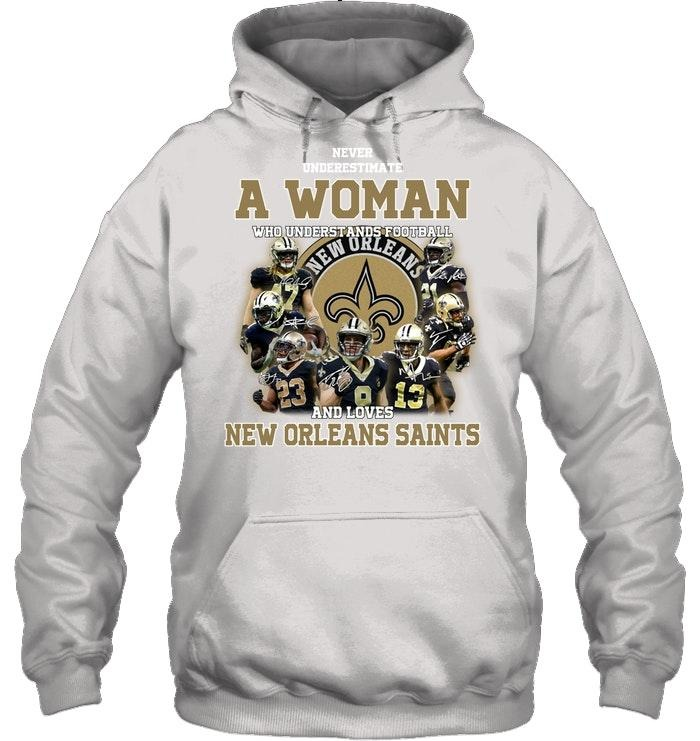 A woman who understand football and love New Orleans Saints shirt and hoodie