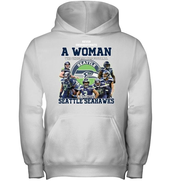 A woman who understand football and love Seatle Seahawks shirt and hoodie