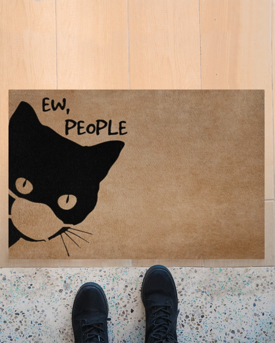 Cat ew people doormat